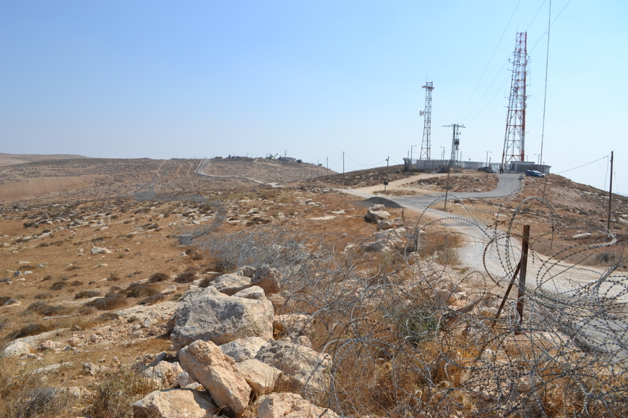 A Jewish settler has pushed IDF fence onto Palestinian land