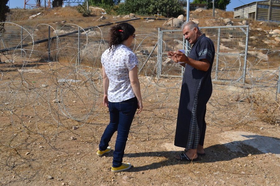 Jewish settler set up that barbed wire fence behind Avital and Ibrahim