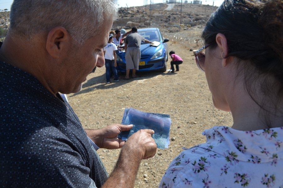 Ibrahim Abu Kbeita shows Avital a photo