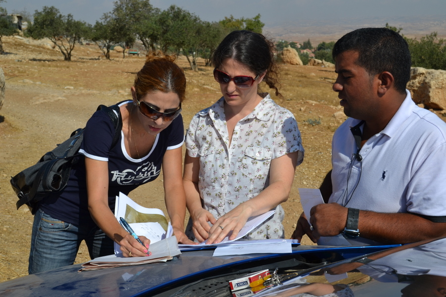 Quamar Mishriqi-Assad and Avital Sharon, examining a map of Abu Kbeita\'s land