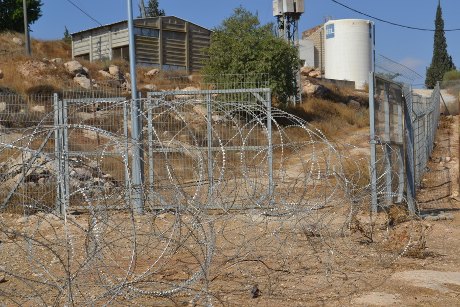 Jewish settler extended this barrier across Ibrahim\'s land