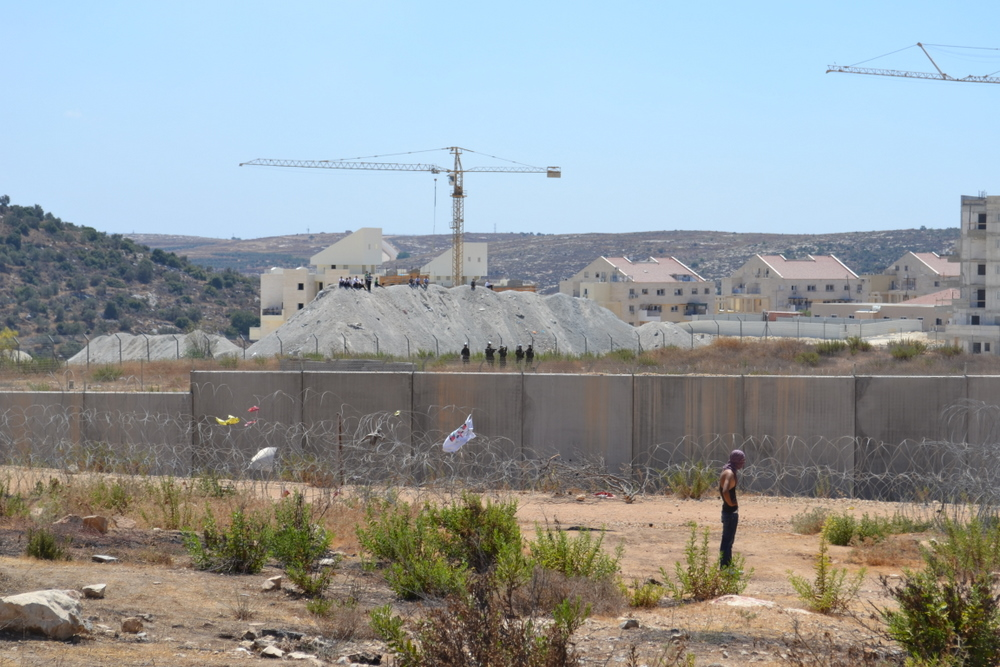 Jewish settlement of Modi\'in Illit on the other side of the wall